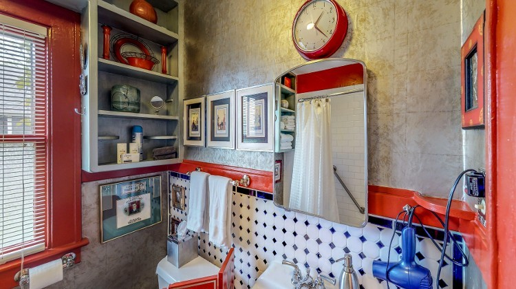 The Bathroom is a Tribute to 1920s Silent Films, Featuring Memorabilia and Art Pieces from the Era when the House was Built | Retro Inspired Bathroom Design